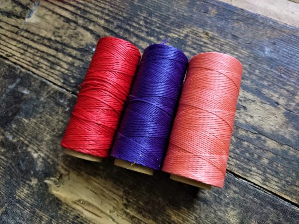 Red, pink and purple waxed thread