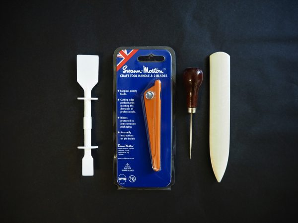 Bookbinding Tools: Glue applicator, craft knife, awl and bone folder