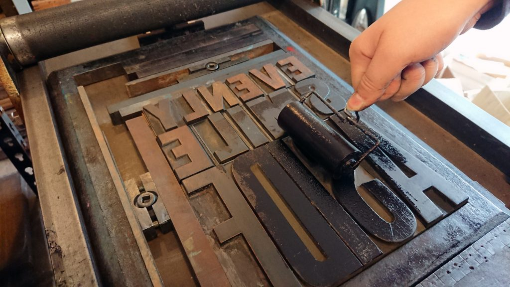 Print a Poster framed inking up the wooden type